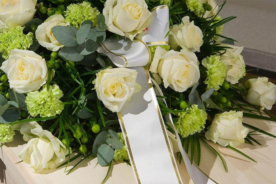 napis na szarfie pogrzebowej